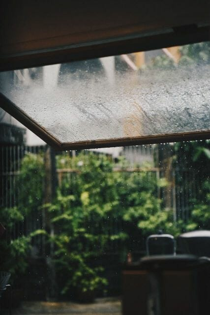 Shoot from a safe distance while rain or snow fall